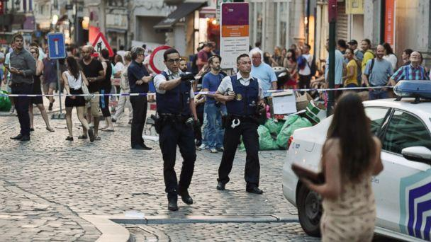 PHOTO: Belgian police evacuate people near the Grand Place near Central Station in Brussels after a reported explosion on Tuesday, June 20, 2017. (Geert Vanden Wijngaert/AP)