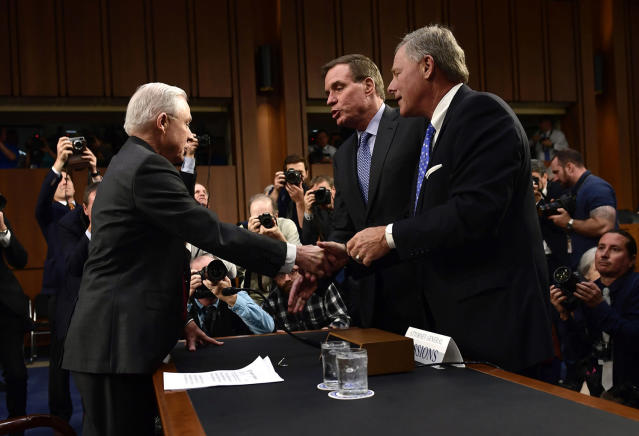 <p>Attorney General Jeff Sessions(L) shakes hands with Sen. Richard Burr(R) Intelligence Committee Chairman and Sen. Mark Warner (C) as he arrives to testify during a US Senate Select Committee on Intelligence hearing on Capitol Hill in Washington, D.C. on June 13, 2017. (Photo: Brendan Smialowski/AFP/Getty Images) </p>