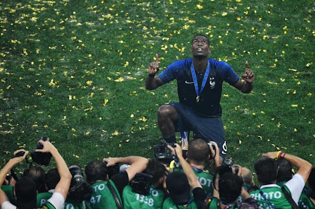 The uncertainty over France World Cup winning midfielder Paul Pogba's future has not helped his club Manchester United with the English Premier League's transfer window closing earlier than their European rivals leading agent Jon Smith told AFP (AFP Photo/GABRIEL BOUYS )