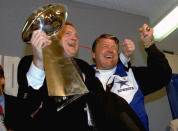 FILE - In this Jan. 31, 1993, file photo, Dallas Cowboys head coach Jimmy Johnson, right, and owner Jerry Jones, hold up the Vince Lombardi Trophy as they celebrate their 52-17 win over the Buffalo Bills in Super Bowl XXVII in Pasadena, Calif. As Jimmy Johnson looks back on the rocky relationship that abruptly ended his championship run with the Dallas Cowboys, he can laugh now. He's heading into the Pro Football Hall of Fame. For Cowboys owner Jerry Jones, the emotions are more complicated. (AP Photo/Rick Bowmer, File)
