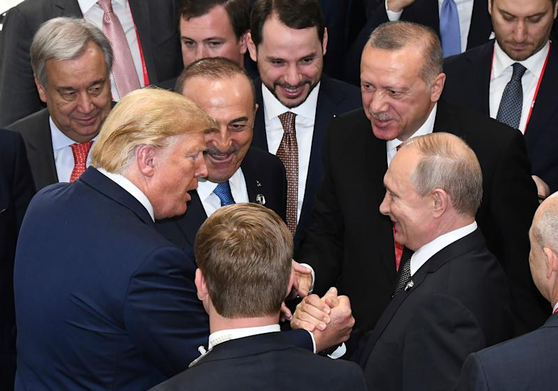 President Donald Trump shakes hands with Russian President Vladimir Putin as Turkey's President Recep Tayyip Erdogan (second from right) and United Nations Secretary-General Antonio Guterres (left) join them on the sidelines of the G-20 summit in Osaka, Japan, on June 29, 2019.  (Photo: Presidential Press Service/Pool via ASSOCIATED PRESS)
