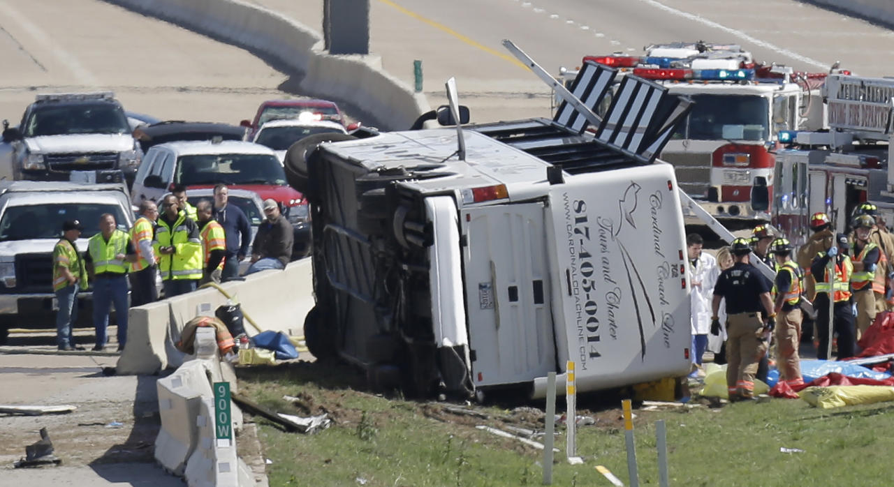 Emergency responders works the scene of bush crash on the George Bush Turnpike Thursday, April 11, 2013, in Irving, Texas. The chartered bus overturned on the busy highway near Dallas killing at least two people and injuring several others, authorities said. (AP Photo/LM Otero)