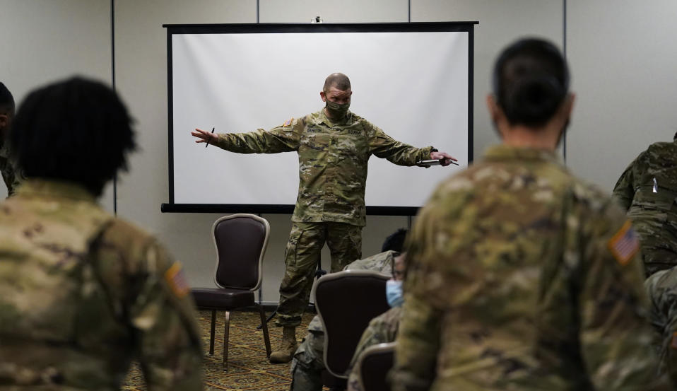 Sergeant Major of the Army Michael Grinston, center, gets feedback from soldiers about their concerns at Fort Hood, Texas, Thursday, Jan. 7, 2021. Following more than two dozen soldier deaths in 2020, including multiple homicides, the U.S. Army Base is facing an issue of distrust among soldiers. (AP Photo/Eric Gay)