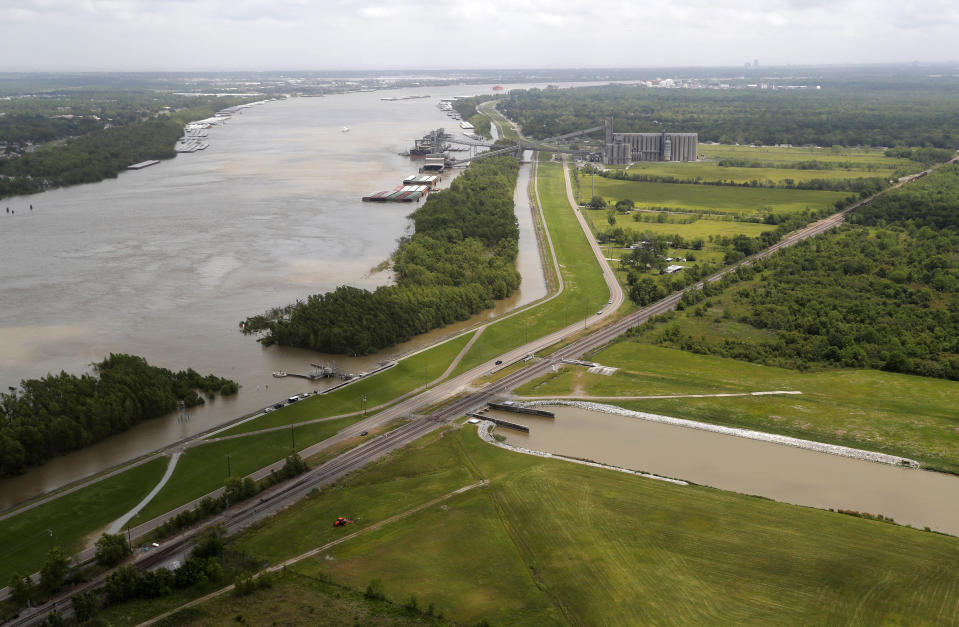 FILE - This May 1, 2019, file photo, shows the Davis Pond Diversion, a project that diverts water from the Mississippi River, left, into the Barataria Basin to reduce coastal erosion in St. Charles Parish, La. A nearly $2 billion plan to divert water and sediment from the Mississippi River to rebuild land in southeastern Louisiana, a proposal considered the cornerstone of the state's efforts to protect its rapidly eroding coast, has passed a major milestone with the publication of the Army Corps of Engineers long-awaited environmental impact study, Thursday, March 4, 2021. (AP Photo/Gerald Herbert, File)