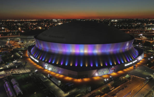 FILE - In this Feb. 1, 2013, file photo, the Superdome, where the NFL Super Bowl XLVII football game between the San Francisco 49ers and Baltimore Ravens will be played on Feb. 3, is seen at sunset in New Orleans. The Superdome has outlasted seven other domed stadiums from the AstroTurf era that have come and gone, even surviving Hurricane Katrina that forced the Saints to play elsewhere in 2005. The spaceship-like building, which opened in 1975, has hosted seven Super Bowls. (AP Photo/Charlie Riedel, File)