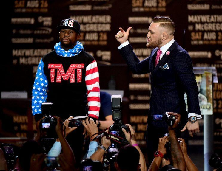Conor McGregor (R) yells at Floyd Mayweather during the first stop of their media tour in Los Angeles. (Getty)