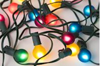 """<p>In a year where everyone could really use a little extra cheer, one of the easiest ways to spread merriment is to go all-out with your outdoor decorations. String lights across bushes, down lamp poles, and—if you dare to climb—along your home's roof line. </p><p><a class=""""link rapid-noclick-resp"""" href=""""https://www.amazon.com/OptiCore-Multicolor-Commercial-Outdoor-Christmas/dp/B076N8W5NK?tag=syn-yahoo-20&ascsubtag=%5Bartid%7C10072.g.34454588%5Bsrc%7Cyahoo-us"""" rel=""""nofollow noopener"""" target=""""_blank"""" data-ylk=""""slk:SHOP OUTDOOR LIGHTS"""">SHOP OUTDOOR LIGHTS</a></p>"""