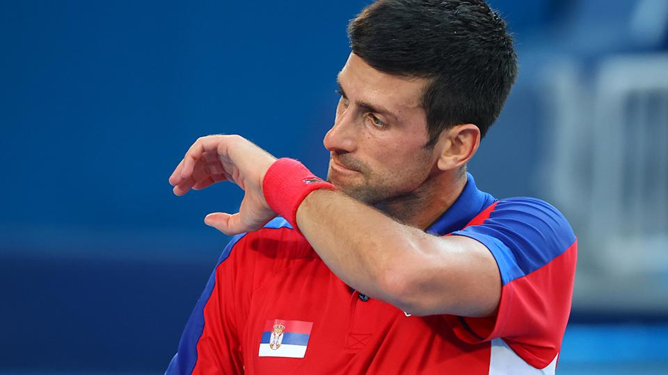 Novak Djokovic, pictured here during his loss to Pablo Carreno Busta in the bronze medal match at the Olympics.