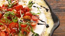 """<p>This will take your BBQ to a new, fancier level. Don't mind us while we dip half a baguette into this bubbling skillet of brie.</p><p>Get the recipe from <a href=""""https://www.delish.com/cooking/recipe-ideas/a20845695/campfire-caprese-brie-recipe/"""" rel=""""nofollow noopener"""" target=""""_blank"""" data-ylk=""""slk:Delish"""" class=""""link rapid-noclick-resp"""">Delish</a>.</p>"""