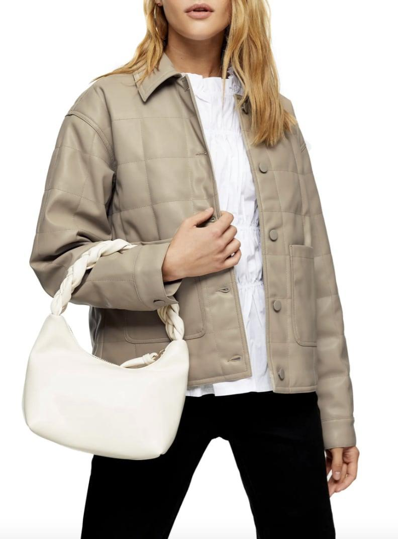 <p>This polished <span>Topshop Boxy Quilt Faux Leather Jacket</span> ($110) is a great choice for any occasion.</p>