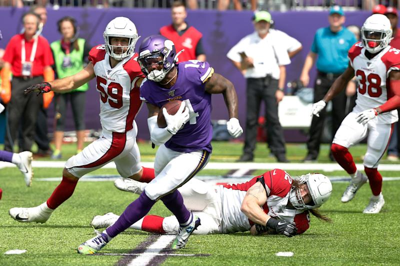 Minnesota Vikings wide receiver Stefon Diggs (14) runs from Arizona Cardinals linebacker Dennis Gardeck, right, after making a reception during the first half of an NFL preseason football game, Saturday, Aug. 24, 2019, in Minneapolis. (AP Photo/Bruce Kluckhohn)