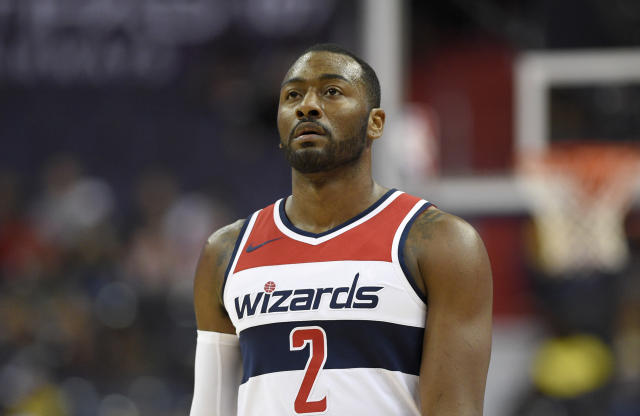 "<a class=""link rapid-noclick-resp"" href=""/nba/teams/was/"" data-ylk=""slk:Washington Wizards"">Washington Wizards</a> guard <a class=""link rapid-noclick-resp"" href=""/nba/players/4716/"" data-ylk=""slk:John Wall"">John Wall</a> wasn't holding back in the Wizards' season opener. (AP)"
