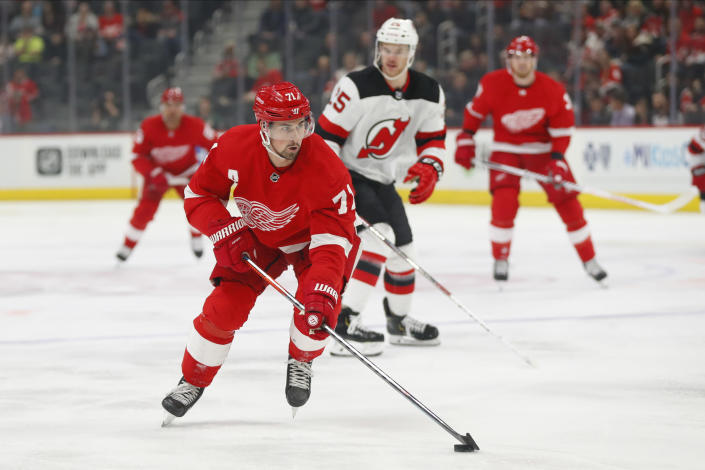 FILE - In this Feb. 25, 2020, file photo, Detroit Red Wings center Dylan Larkin (71) skates with the puck against the New Jersey Devils in the first period of an NHL hockey game in Detroit. The Red Wings are entering the fifth season of a rebuilding project and this still might not be the year that they break through and make the playoffs. (AP Photo/Paul Sancya, File)