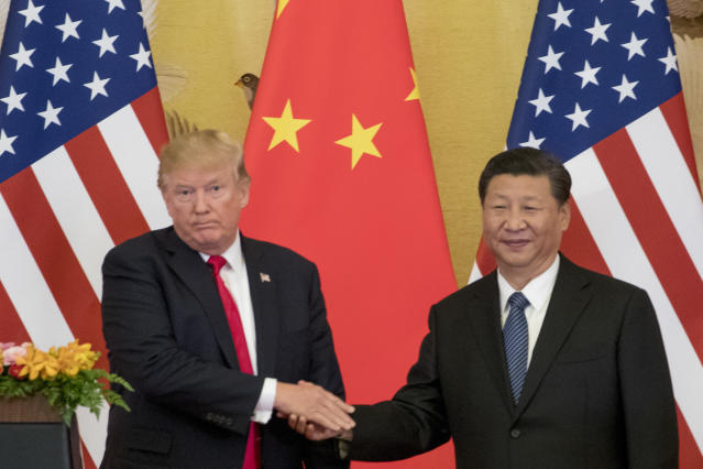 "President Donald Trump and Chinese President Xi Jinping shake hands during a joint statement to members of the media Great Hall of the People in Beijing, China. The U.S. is announcing that it will impose a 25 percent tariff on $50 billion worth of Chinese goods containing ""industrially significant technology."" The White House said Tuesday, May 29, 2018, that the tariff will cover goods related to the ""Made in China 2025"" program. The full list of imports that will be covered will be announced by June 15. (AP Photo/Andrew Harnik)"