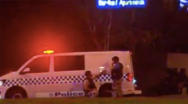 Officers at the scene of the siege in Brighton. Photo: 7 News