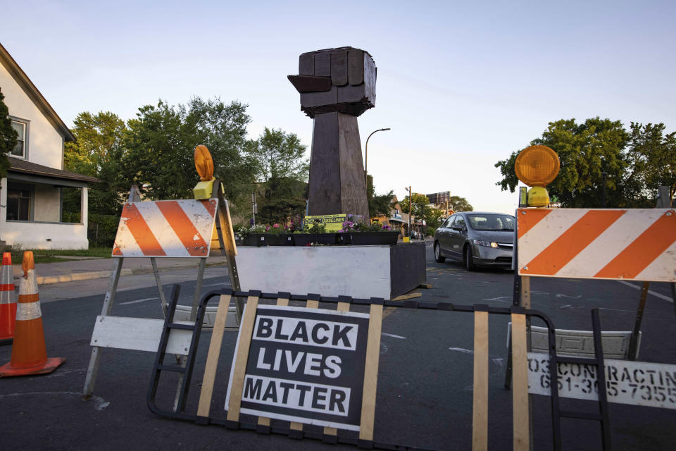 New barricades close off the streets to 38th Street and Chicago Avenue as community members gather in George Floyd Square to demand justice for Winston Boogie Smith Jr., on Monday, June 7, 2021. Smith was fatally shot by members of a U.S. Marshals task force. (AP Photo/Christian Monterrosa)