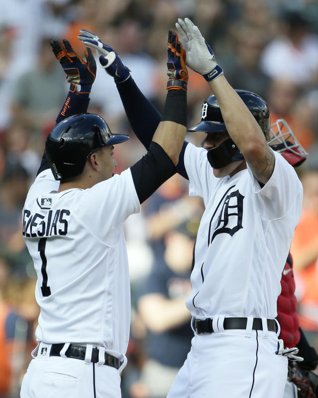 Detroit Tigers' JaCoby Jones, right, celebrates his two-run home run against the Cleveland Indians with Jose Iglesias during the third inning of a baseball game Saturday, July 28, 2018, in Detroit. (AP Photo/Duane Burleson)