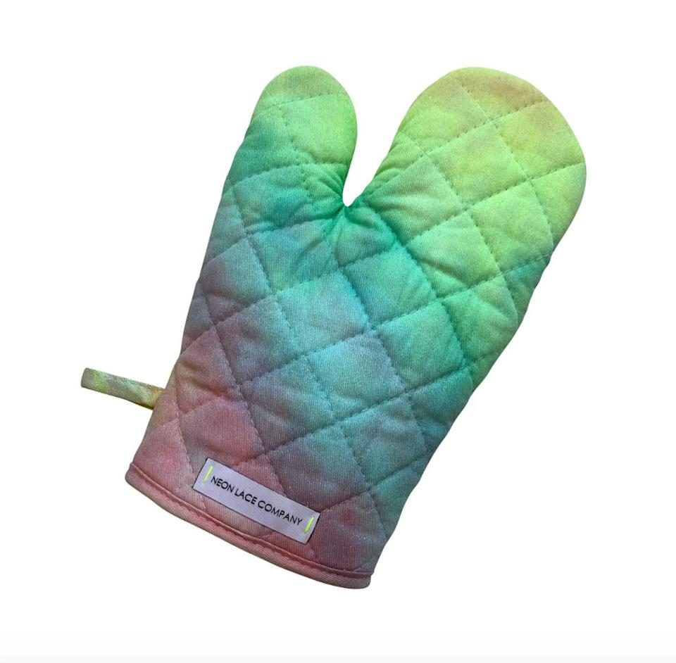 """<p>Before your loved ones start in on their holiday baking, be sure to gift them one of these hand-dyed rainbow watercolor oven mitts. The best part: each sale benefits someone else who loves to cook: $2 from every Unicorn mitt will be donated to <a href=""""https://www.theokraproject.com/"""" rel=""""nofollow noopener"""" target=""""_blank"""" data-ylk=""""slk:the Okra Project"""" class=""""link rapid-noclick-resp"""">the Okra Project</a>, an organization that supports black trans chefs and their community in New York City.</p> <p><strong>Buy It!</strong> $25, <a href=""""https://www.neonlacecompany.com/new-products-2/unicorn-oven-mitt"""" rel=""""nofollow noopener"""" target=""""_blank"""" data-ylk=""""slk:neonlacecompany.com"""" class=""""link rapid-noclick-resp"""">neonlacecompany.com</a></p>"""