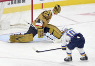 Vegas Golden Knights goaltender Marc-Andre Fleury (29) makes a save against St. Louis Blues center Brayden Schenn (10) during the second period of an NHL hockey game Saturday, May 8, 2021, in Las Vegas. (AP Photo/David Becker)