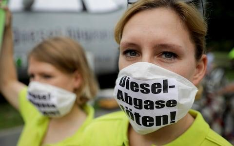 Campaigners in Germany protest about diesel in the wake of the VW scandal - Credit: DPA
