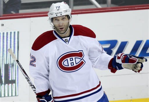 Montreal Canadiens' Erik Cole (72) celebrates his goal in the first period of an NHL hockey game against the Pittsburgh Penguins in Pittsburgh, Friday, Jan. 20, 2012. (AP Photo/Gene J. Puskar)
