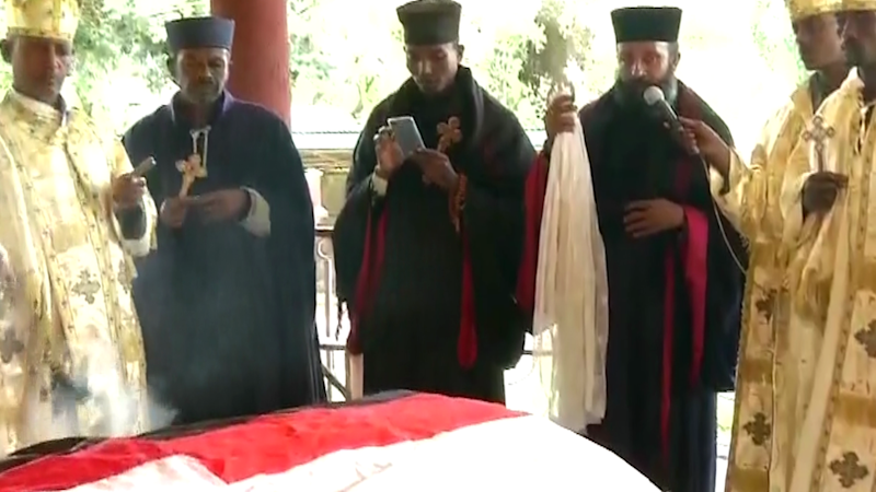 Priests around the coffin of Hachalu Hundessa