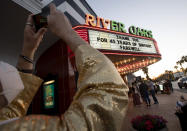 David Purdie takes a photograph of the River Oaks Theatre farewell marquee sign on the final day of showing films Thursday, March 25, 2021, in Houston. Purdie, who grew up in the neighborhood, said he has been coming to the theater and watching films since 1971. (Yi-Chin Lee/Houston Chronicle via AP)