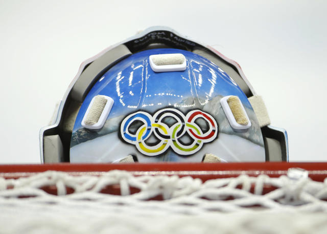 Norway goaltender Lars Haugen wears a protective mask decorated with the Olympic rings during a training session at the Bolshoy Ice Dome at the the 2014 Winter Olympics, Sunday, Feb. 9, 2014, in Sochi, Russia. (AP Photo/Mark Humphrey)