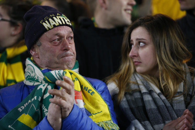 A Nantes soccer supporters cries during an homage to Argentinian player Emiliano Sala in La Beaujoire stadium before the French League One soccer match Nantes against Saint-Etienne, in Nantes, western France, Wednesday, Jan.30, 2019. Sala disappeared over the English Channel on Jan. 21, 2019 as it flew from France to Wales. Sala had just been signed by Premier League club Cardiff. (AP Photo/Thibault Camus)