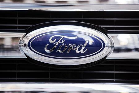 A Ford logo is seen on the grill of a 2015 F-150 truck outside the New York Stock Exchange in the Manhattan borough of New York, January 13, 2014. REUTERS/Lucas Jackson