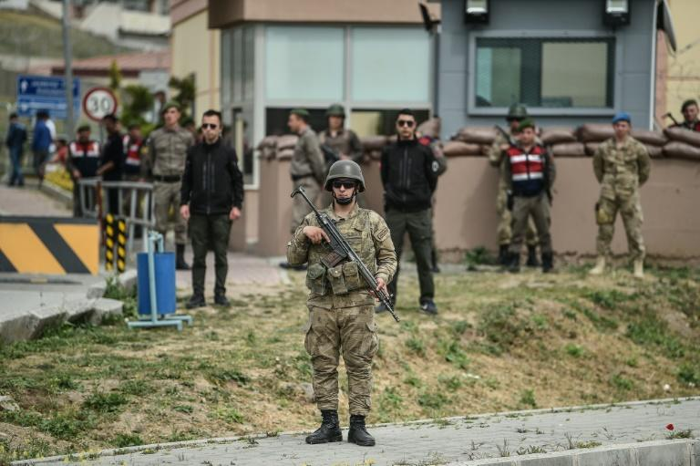 Turkish soldiers stand guard at the entrance of the Aliaga court and prison complex where the trial of American pastor Andrew Brunson on terror and spy charges resumed Monday