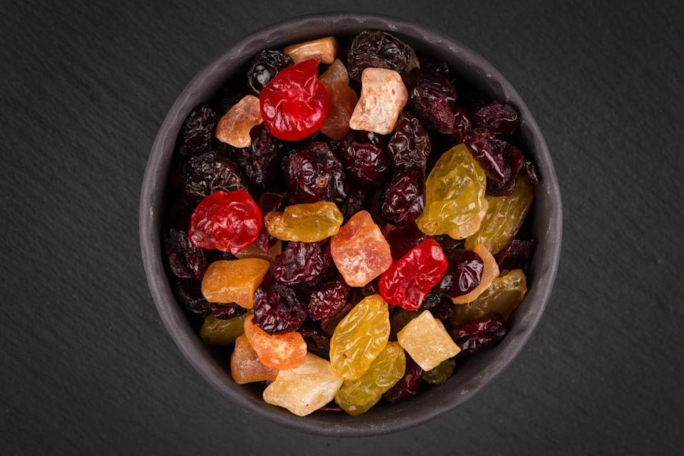 """<p>Of course, fruit by itself is healthy. But the dried versions can be a """"slippery slope,"""" says Beth Warren, R.D.N., founder of Beth Warren Nutrition and author of <em><a href=""""https://www.amazon.com/Secrets-Kosher-Girl-21-Day-Nourishing/dp/1682614999?tag=syn-yahoo-20&ascsubtag=%5Bartid%7C10063.g.36013013%5Bsrc%7Cyahoo-us"""" rel=""""nofollow noopener"""" target=""""_blank"""" data-ylk=""""slk:Secrets of a Kosher Girl"""" class=""""link rapid-noclick-resp"""">Secrets of a Kosher Girl</a></em>. """"Once dried, it's concentrated with sweetness and shrinks in size, making it more likely for people to eat more of it than the whole fruit option,"""" she says.</p>"""