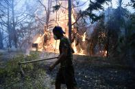 Flames burn a forrest during a wildfire in Adames area, in northern Athens, Greece, Tuesday, Aug. 3, 2021.Thousands of people fled their homes north of Athens on Tuesday as a wildfire broke out of the forest and reached residential areas. The hurried evacuations took place just as Greece grappled with its worst heat wave in decades. (AP Photo/Michael Varaklas)