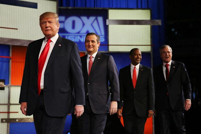 <p>Republican candidates, from left, Donald Trump, Sen. Ted Cruz, Ben Carson and Jeb Bush arrive to participate in the presidential debate at the North Charleston Coliseum and Performing Arts Center on Jan. 14, 2016 in North Charleston, S.C.<i> (Photo: Andrew Burton/Getty Images)</i></p>