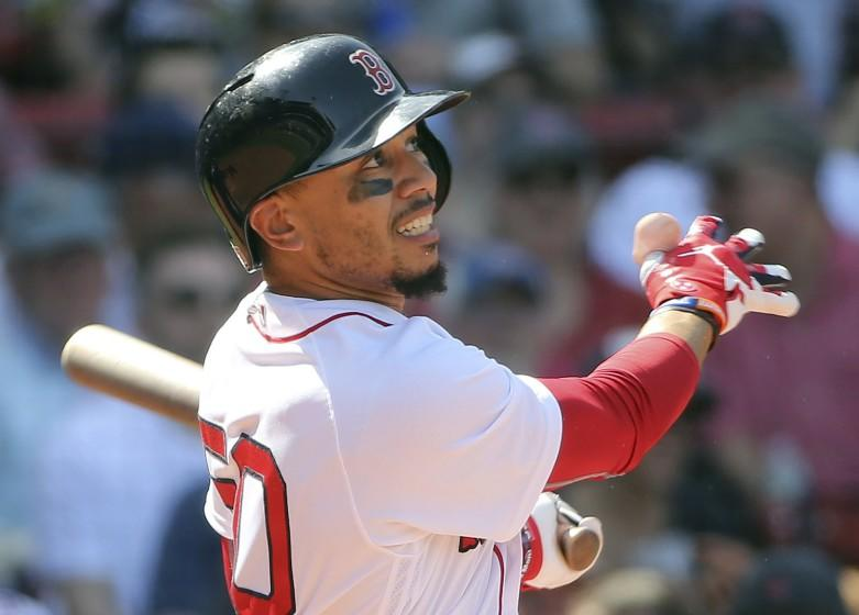 Boston Red Sox's Mookie Betts follows through with his third home run of the game in the seventh inning of a baseball game against the Kansas City Royals at Fenway Park, Wednesday, May 2, 2018, in Boston. (AP Photo/Elise Amendola)