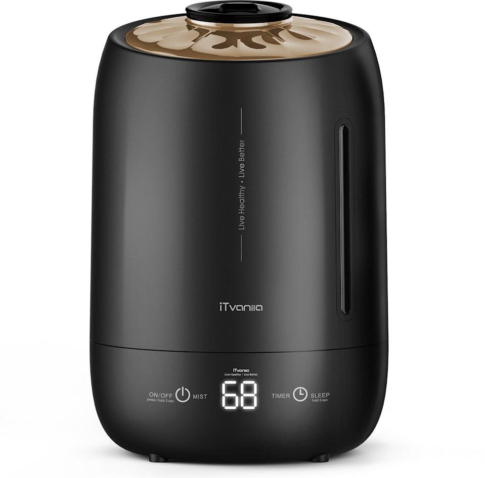 "<strong>The Sleek Humidifier</strong><br>This stylish matte-black model is a compact five liter cool-misting machine, complete with a touch-screen digital display for misting levels and on-time room temperature.<br><br><strong>The Hype:</strong> 4.1 out of 5 stars on <a href=""https://amzn.to/3nBRDKn"" rel=""nofollow noopener"" target=""_blank"" data-ylk=""slk:Amazon"" class=""link rapid-noclick-resp"">Amazon</a>.<br><br><strong>Air Aficionados Say:</strong> ""It is so elegant...It has many different settings such as different moist level, sleep mode etc...I can feel the difference when its on."" — Amazon Customer, Amazon Review<br><br><strong>iTvanila</strong> Cool Mist Humidifier, $, available at <a href=""https://amzn.to/2UEH5gM"" rel=""nofollow noopener"" target=""_blank"" data-ylk=""slk:Amazon"" class=""link rapid-noclick-resp"">Amazon</a>"