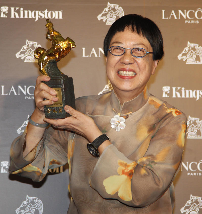 """Hong Kong director Ann Hui holds her award for Best Director at the 48th Golden Horse Awards, Saturday, Nov. 26, 2011, in Hsinchu, northern Taiwan. Ann Hui won for the film """" A Simple Life """" at this year's Golden Horse Awards -the Chinese-language film industry's biggest annual event. (AP Photo/Wally Santana)"""