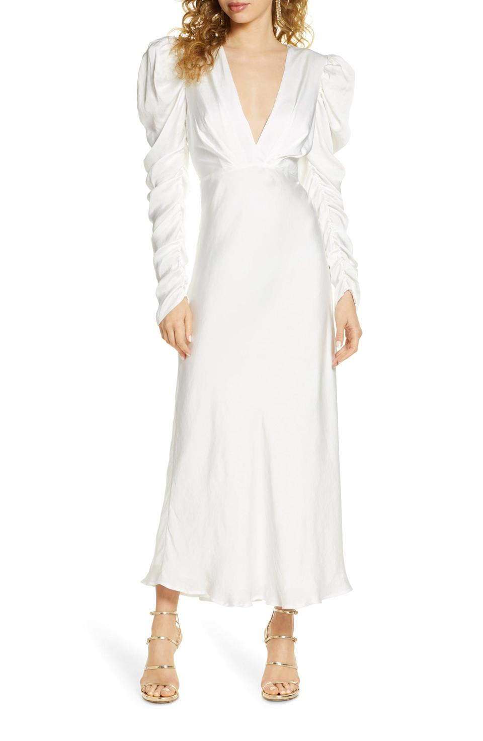 """<p>If you want something that doesn't touch the ground, we adore this <a href=""""https://www.popsugar.com/buy/Bardot-Zaria-Long-Sleeve-Gown-582315?p_name=Bardot%20Zaria%20Long-Sleeve%20Gown&retailer=shop.nordstrom.com&pid=582315&price=129&evar1=fab%3Aus&evar9=47551973&evar98=https%3A%2F%2Fwww.popsugar.com%2Fphoto-gallery%2F47551973%2Fimage%2F47552368%2FBardot-Zaria-Long-Sleeve-Gown&list1=shopping%2Cwedding%2Cbride%2Cwedding%20dresses%2Cfashion%20shopping%2Cbest%20of%202020&prop13=api&pdata=1"""" class=""""link rapid-noclick-resp"""" rel=""""nofollow noopener"""" target=""""_blank"""" data-ylk=""""slk:Bardot Zaria Long-Sleeve Gown"""">Bardot Zaria Long-Sleeve Gown</a> ($129).</p>"""