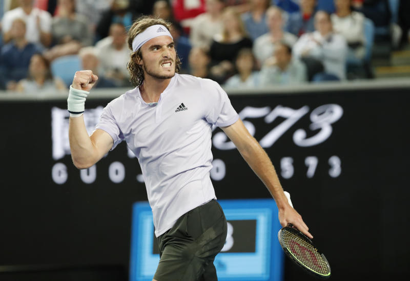 Stefanos Tsitsipas, pictured here celebrating after winning against Italy's Salvatore Caruso.