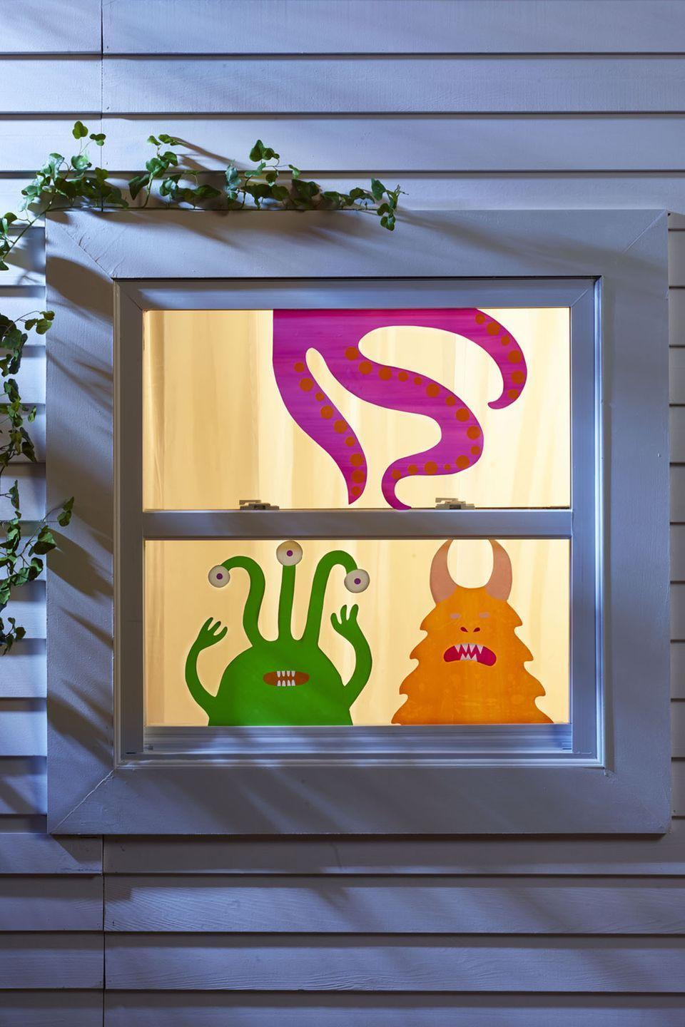 """<p>These colorful creatures can keep an eye on the neighborhood even when you're not home. Print the templates, then trace, and cut them out from contact paper.</p><p><em><a href=""""https://www.womansday.com/home/crafts-projects/g3200/halloween-2017-templates/"""" rel=""""nofollow noopener"""" target=""""_blank"""" data-ylk=""""slk:Get the Neighborhood Watch template"""" class=""""link rapid-noclick-resp"""">Get the Neighborhood Watch template</a>.</em></p><p><strong>What You'll Need</strong>: <a href=""""https://www.amazon.com/Tact-Brand-Covering-Self-Adhesive-Semi-Transparent/dp/B00R8AWBJI/ref=sr_1_1?dchild=1&keywords=contact+paper&qid=1595003262&sr=8-1&tag=syn-yahoo-20&ascsubtag=%5Bartid%7C10070.g.1279%5Bsrc%7Cyahoo-us"""" rel=""""nofollow noopener"""" target=""""_blank"""" data-ylk=""""slk:Contact paper"""" class=""""link rapid-noclick-resp"""">Contact paper </a>($6, Amazon); colored <a href=""""https://www.amazon.com/Astrobrights-Spectrum-25-Color-Assortment-80933-01/dp/B01GUUARV0/ref=sr_1_8?dchild=1&keywords=colored+construction&qid=1595003315&sr=8-8&tag=syn-yahoo-20&ascsubtag=%5Bartid%7C10070.g.1279%5Bsrc%7Cyahoo-us"""" rel=""""nofollow noopener"""" target=""""_blank"""" data-ylk=""""slk:construction paper"""" class=""""link rapid-noclick-resp"""">construction paper </a>($7, Amazon)<br></p>"""