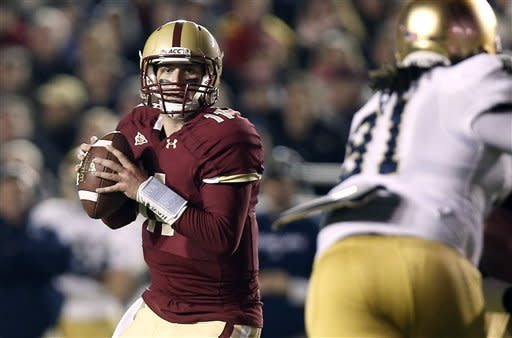 Boston College quarterback Chase Rettig looks downfield during the first half of an NCAA college football game against Notre Dame in Boston on Saturday, Nov. 10, 2012. (AP Photo/Winslow Townson)