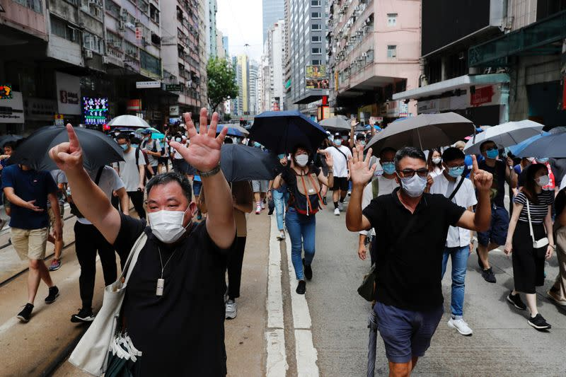 Anti-national security law protesters march at the anniversary of Hong Kong's handover to China from Britain in Hong Kong