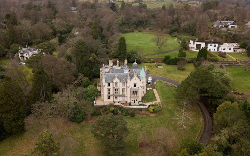 A turreted castle rented out on Airbnb is being 'turned into a mini-Glastonbury Festival' by unruly guests - who have been accused of sectarian singing and lobbing Buckfast bottles - SWNS
