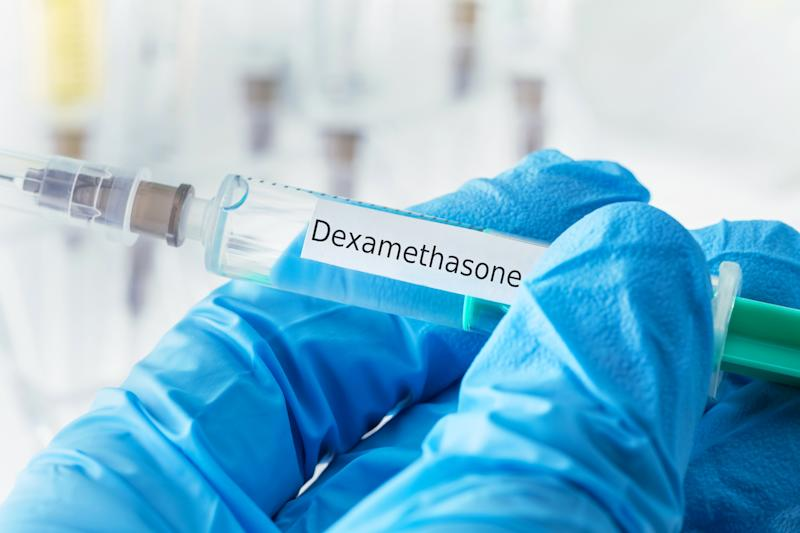 dexamethasone drug syringe in blue gloved hands