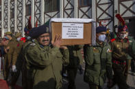 Indian police officers carry the coffin of their colleague Mohammad Yousuf during a wreath laying ceremony in Srinagar, Indian controlled Kashmir, Friday, Feb. 19, 2021. Anti-India rebels in Indian-controlled Kashmir killed two police officers in an attack Friday in the disputed region's main city, officials said. Elsewhere in the Himalayan region, three suspected rebels and a policeman were killed in two gunbattles. (AP Photo/ Dar Yasin)