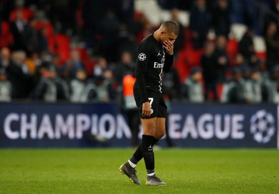 Mbappe looks dejected (REUTERS)