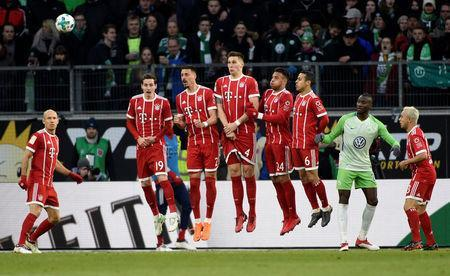 Soccer Football - Bundesliga - VfL Wolfsburg vs Bayern Munich - Volkswagen Arena, Wolfsburg, Germany - February 17, 2018 Bayern Munich's Niklas Sule, Sandro Wagner and team mates jump to defend a free kick REUTERS/Fabian Bimmer
