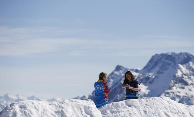 Volunteers enjoy a sunny afternoon on top of the mountain of Rosa Khutor during the 2014 Sochi Winter Olympics,