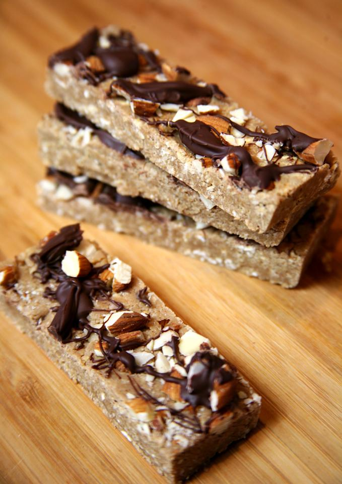 "<p>If you love the ease of grabbing a protein bar, but you don't want to pay tons of money and don't love some of the odd ingredients you find in them, make a big batch of your own. These chocolate almond protein bars are vegan, gluten-free, and can be frozen.</p> <p><strong>Calories:</strong> 332 (for two bars)<br> <strong>Protein:</strong> 25.6 grams</p> <p><strong>Get the recipe:</strong> <a href=""https://www.popsugar.com/fitness/Vegan-Protein-Bars-33473756"" class=""ga-track"" data-ga-category=""Related"" data-ga-label=""http://www.popsugar.com/fitness/Vegan-Protein-Bars-33473756"" data-ga-action=""In-Line Links"">chocolate almond protein bars</a></p>"