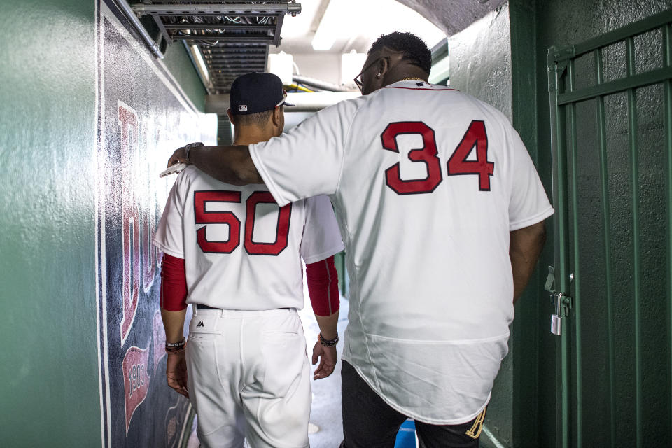 BOSTON, MA - JULY 30: Former Boston Red Sox player David Ortiz walks through a hallway with Mookie Betts #50 of the Boston Red Sox before a 2007 World Series Champion team reunion before a game against the Kansas City Royals on July 30, 2017 at Fenway Park in Boston, Massachusetts. (Photo by Billie Weiss/Boston Red Sox/Getty Images)
